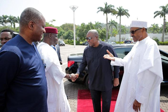 Nigerian President Muhammadu Buhari (right) held crisis talks in Abuja on January 9, where regional leaders discussed the political situation in Gambia (AFP Photo/SUNDAY AGHAEZE)