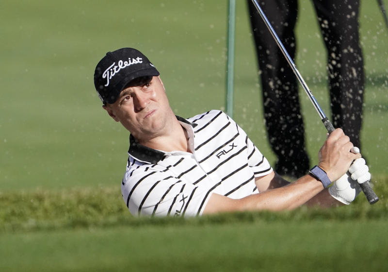 Justin Thomas of the United States watches a ball from a bunker on the 9th hole during the pro-am event of the Zozo Championship PGA Tour at Accordia Golf Narashino C.C. in Inzai, east of Tokyo, Japan, Wednesday, Oct. 23, 2019. (AP Photo/Lee Jin-man)