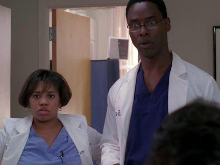 Burke and Bailey in scrubs and coats in a hospital room on Greys Anatomy