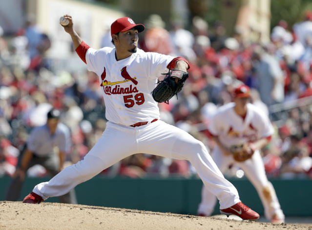 FILE - In this March 15, 2013 file photo, St. Louis Cardinals relief pitcher Fernando Salas throws during the eighth inning of an exhibition spring training baseball game against the Washington Nationals, in Jupiter, Fla. The Cardinals have traded former World Series MVP David Freese to the Los Angeles Angels in a four-player deal. The Cardinals also sent reliever Fernando Salas to the Angels on Friday, Nov. 22, 2013, in exchange for outfielder Peter Bourjos and prospect Randal Grichuk. (AP Photo/Jeff Roberson, File)