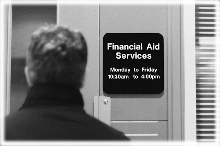 College student entering a financial aid services office