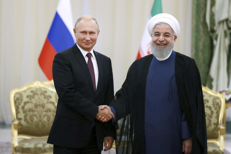 Iran's President Hassan Rouhani, right, shakes hands with Russia's President Vladimir Putin, in Tehran, Iran, Friday, after their talks, part of Russia-Iran-Turkey summit to discuss Syria, Friday Sept. 7, 2018. Putin, Erdogan and Iran's President Hassan Rouhani began a meeting Friday in Tehran to discuss the war in Syria, with all eyes on a possible military offensive to retake the last rebel-held bastion of Idlib. (AP Photo/Ebrahim Noroozi)