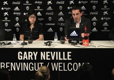 Valencia's new coach Gary Neville attends a news conference next to the club's president Chan Lay Hoon during his presentation at the Mestalla stadium in Valencia