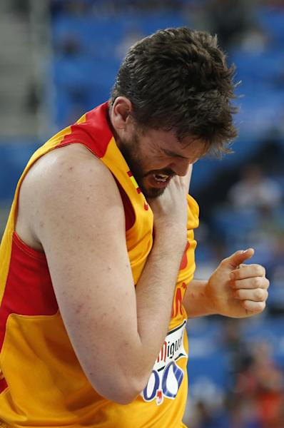 Spain's Marc Gasol, reacts, after suffering an injury during the EuroBasket European Basketball Championship semifinal match against France in Ljubljana, Slovenia, Friday, Sept. 20, 2013. (AP Photo/Petr David Josek)