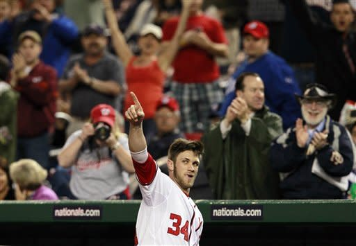 Washington Nationals left fielder Bryce Harper acknowledges the crowd after hitting his first major-league home run during the third inning of baseball game against the San Diego Padres, Monday, May 14, 2012 in Washington. (AP Photo/Haraz N. Ghanbari)