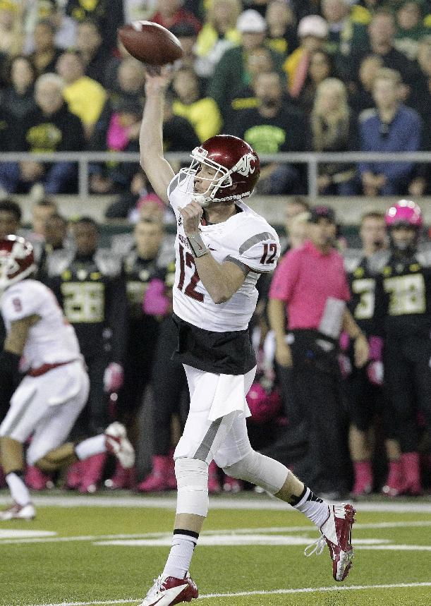 Washington State quarterback Connor Halliday unleashes a pass during the first half of an NCAA college football game against Oregon in Eugene, Ore., Saturday, Oct. 19, 2013. (AP Photo/Don Ryan)