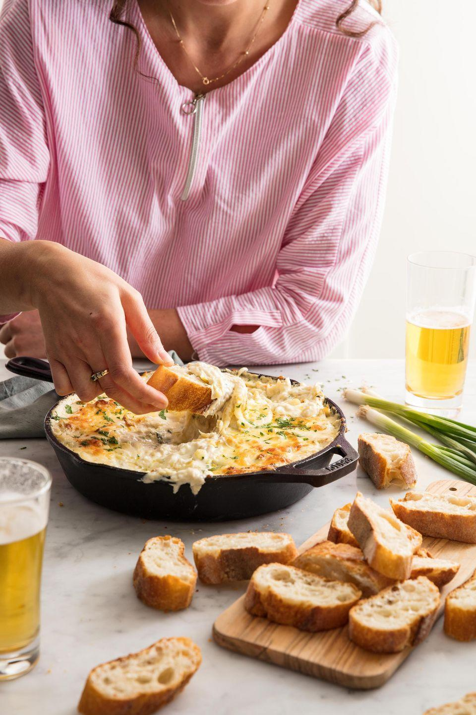 "<p>It's the classy AF dip that'll slay your party.</p><p>Get the recipe from <a href=""/cooking/recipe-ideas/recipes/a49883/crab-artichoke-dip-recipe/"" data-ylk=""slk:Delish"" class=""link rapid-noclick-resp"">Delish</a>.</p>"
