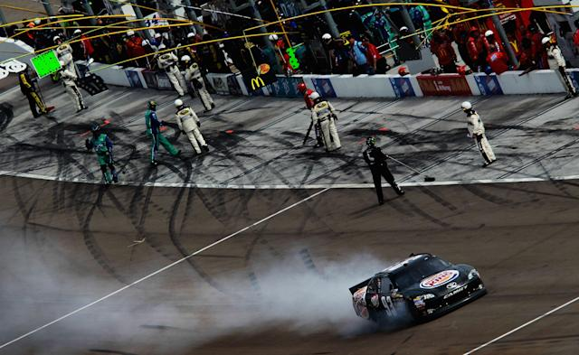 LAS VEGAS, NV - MARCH 11: Smoke flies from the #93 Burger King Toyota, driven by Travis Kvapil, after an incident in the NASCAR Sprint Cup Series Kobalt Tools 400 at Las Vegas Motor Speedway on March 11, 2012 in Las Vegas, Nevada. (Photo by Ronald Martinez/Getty Images for NASCAR)
