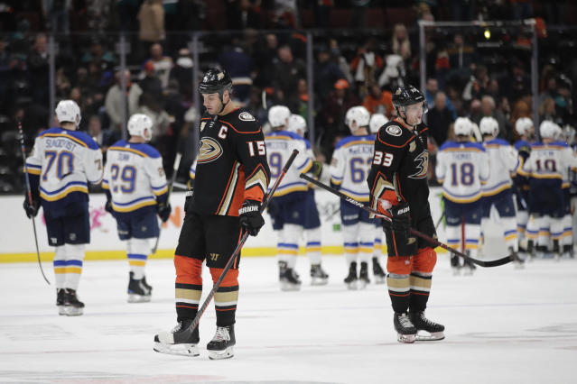 Anaheim Ducks' Ryan Getzlaf, left, and Jakob Silfverberg, of Sweden, stand on the ice after the team's 5-4 loss to the St. Louis Blues in an NHL hockey game Wednesday, March 6, 2019, in Anaheim, Calif. (AP Photo/Jae C. Hong)