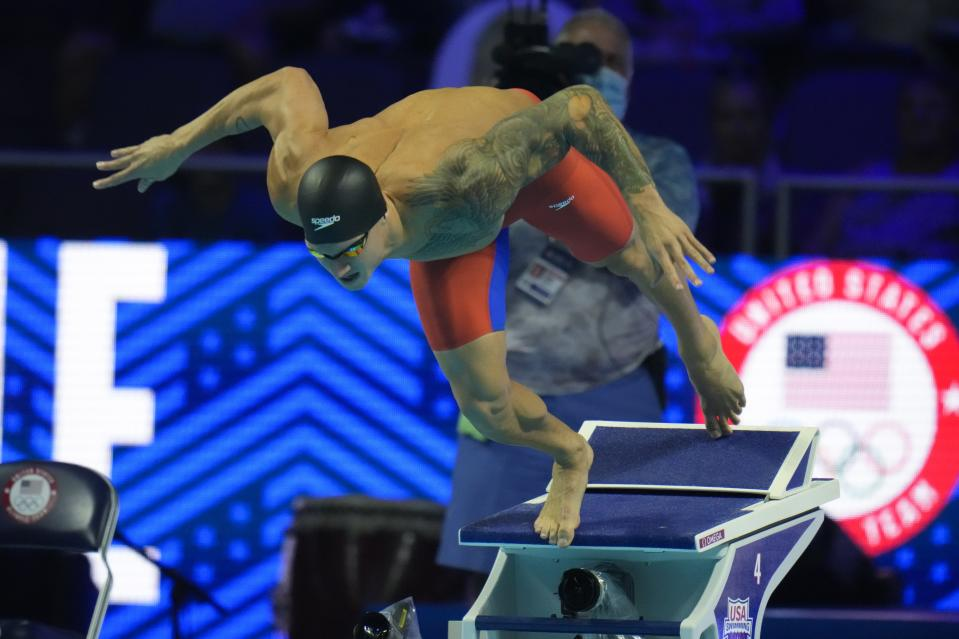 FILE - In this June 20, 2021, file photo, Caeleb Dressel participates in the men's 50 freestyle during wave 2 of the U.S. Olympic Swim Trials in Omaha, Neb. For a man tabbed as swimming's next superstar, Dressel could not be more disinterested. Of course, he cares about being fast in the pool. He just is not into anyone else's expectations or comparisons. Fame is not his thing, either. (AP Photo/Jeff Roberson, File)