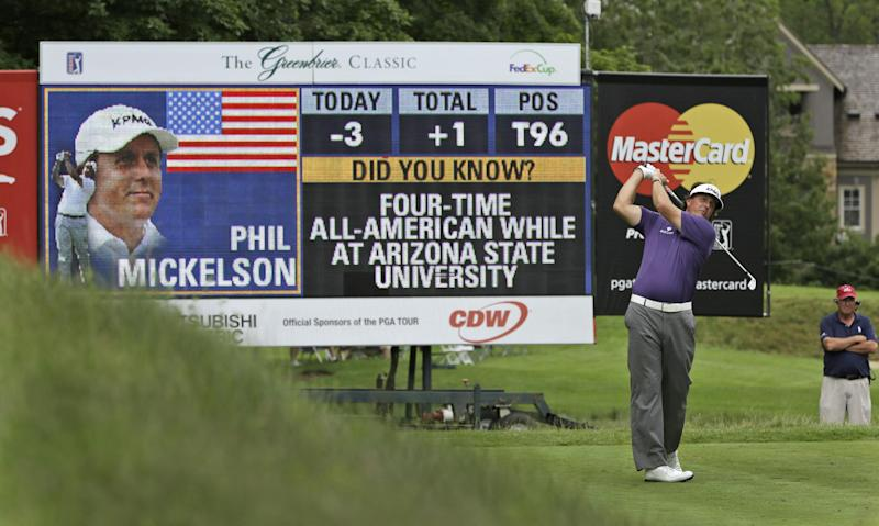 Phil Mickelson watches his tee shot on the eighth hole during the second round of the Greenbrier Classic PGA tour golf tournament in White Sulphur Springs, W.Va., Friday, July 5, 2013. Mickelson ended the day at 2 over par for the tourney (AP Photo/Steve Helber)