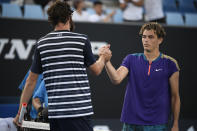 United States' Taylor Fritz is congratulated by compatriot Reilly Opelka after their second round match at the Australian Open tennis championship in Melbourne, Australia, Wednesday, Feb. 10, 2021. (AP Photo/Andy Brownbill)