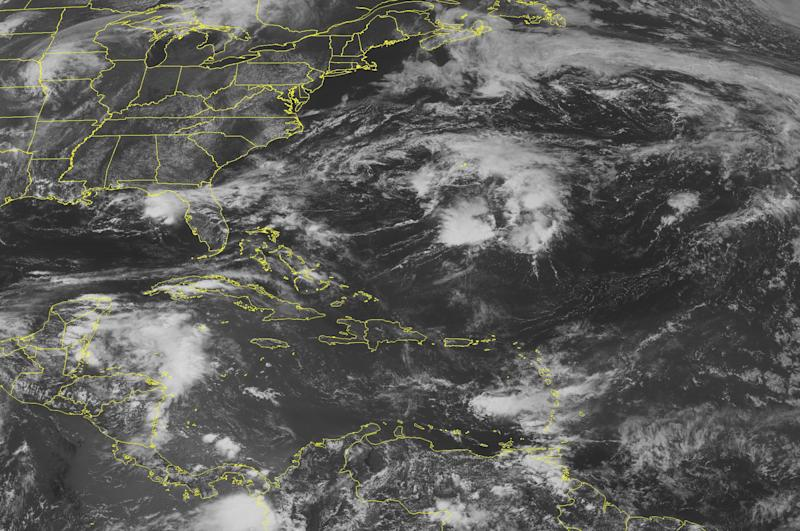This NOAA satellite image taken Friday, June 15, 2012 at 1:45 PM EDT shows dense cloud cover over the northwestern basin as circulation from a remnant tropical wave sirs up scattered showers and thunderstorms in the region.  Similar activity forms in the southwestern basin as an area of low pressure becomes embedded in the monsoon trough that extends from Colombia to portions of western Panama and Costa Rica. Meanwhile, a few weak isolated showers are embedded in moderate to fresh easterly trade winds.  (AP PHOTO/WEATHER UNDERGROUND)