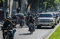 A caravan carrying Venezuelan opposition leader and self-proclaimed acting president Juan Guaido to the National Assembly, followed by journalists on motorcycles