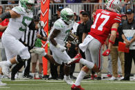 Oregon running back CJ Verdell, center, scores a touchdown against Ohio State during the first half of an NCAA college football game Saturday, Sept. 11, 2021, in Columbus, Ohio. (AP Photo/Jay LaPrete)