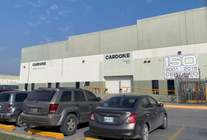 Cars are parked outside the Tridonex auto-parts plant, owned by Philadelphia-based Cardone Industries, in Matamoros