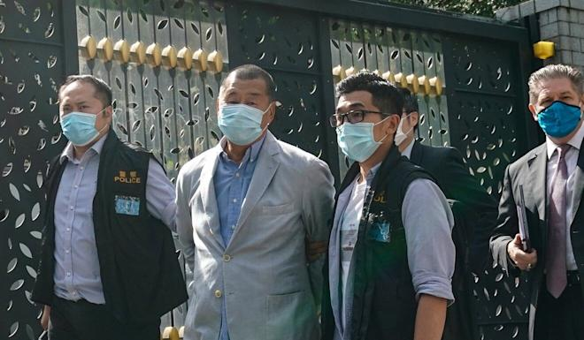 Media mogul Jimmy Lai being escorted by police from his home. Photo: Felix Wong