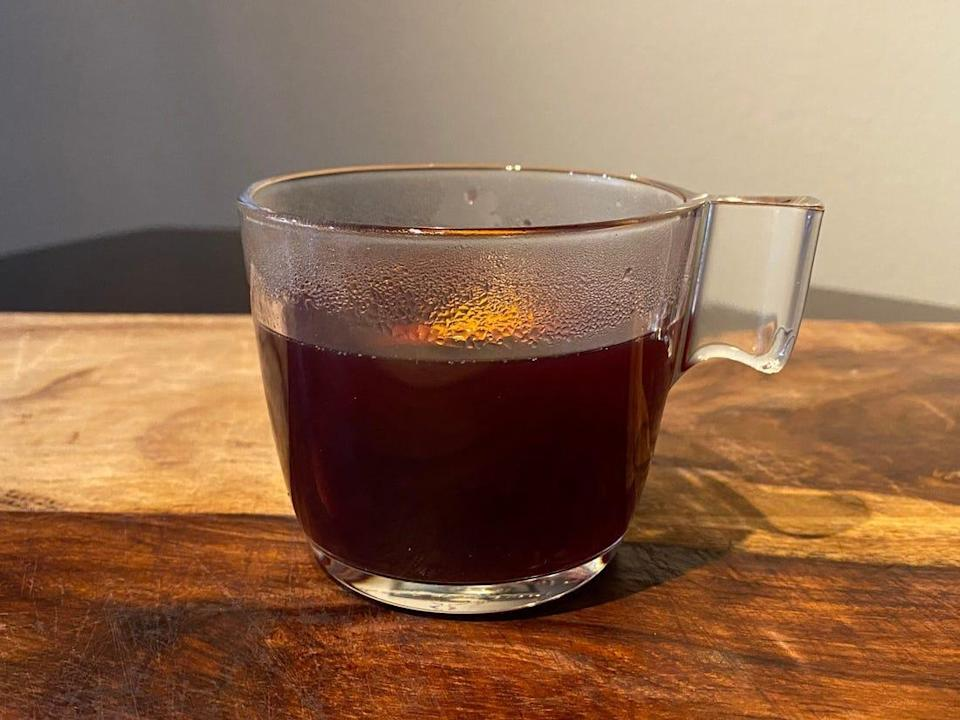 Mulled wine in a glass cup.