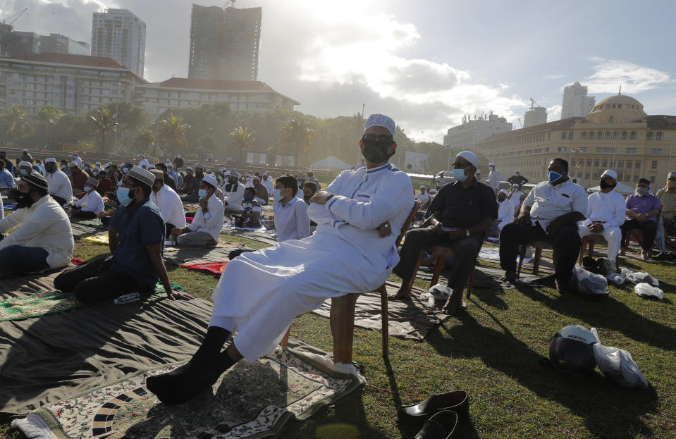 Sri Lankan Muslims attend a prayer session to mark Eid al-Adha, or Feast of Sacrifice, in Colombo, Sri Lanka, Saturday, Aug. 1, 2020. The feast is marked by sacrificing animals to commemorate the prophet Ibrahim's faith in being willing to sacrifice his son. (AP Photo/Eranga Jayawardena)