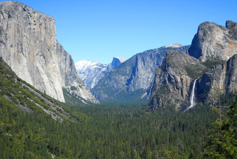 This April 2013 image shows  Yosemite Valley as seen from Tunnel View with three of Yosemite National Park's best-known natural attractions: The El Capitan summit on the left, the granite peak known as Half Dome in the distant center, and Bridalveil Fall  on the right.  The park, in California, is one of the nation's most-visited national parks. (AP Photo/Kathy Matheson)