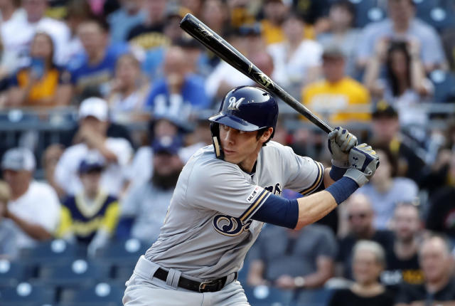 FILE - In this May 31, 2019, file photo, Milwaukee Brewers' Christian Yelich bats during a baseball game against the Pittsburgh Pirates in Pittsburgh. Yelich, who fractured his kneecap late in the season, still may have done enough to win a second straight MVP award. The Milwaukee outfielder hit 44 home runs and won the so-called slash line Triple Crown by leading the NL in batting average, on-base percentage and slugging percentage. (AP Photo/Gene J. Puskar, File)