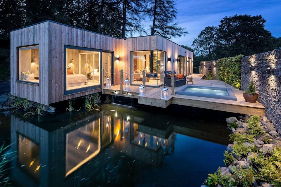 "<p>Whichever way we look at it, Christmas 2020 is going to be different – so why not embrace the change and escape to a secluded cabin à deux? Gilpin in the Lake District has just launched its Spa Suites, set between silent fells and woodland. Each has floor-to-ceiling windows, a decked garden and a hot tub, with a fireplace, cocktail bar and circular stone bath indoors – along with a steam-room, sauna, infrared lounge bed and massage chair. There's enough to keep you entertained (and serene) in your suite, but the hotel has also created a sensory trail designed to relax you even further, with everything geared towards optimum wellbeing. Expect salt scrubs and chilli in your green tea (trust us).</p><p>From £850 a room a night (<a href=""http://www.thegilpin.co.uk"" rel=""nofollow noopener"" target=""_blank"" data-ylk=""slk:thegilpin.co.uk"" class=""link rapid-noclick-resp"">thegilpin.co.uk</a>).</p>"