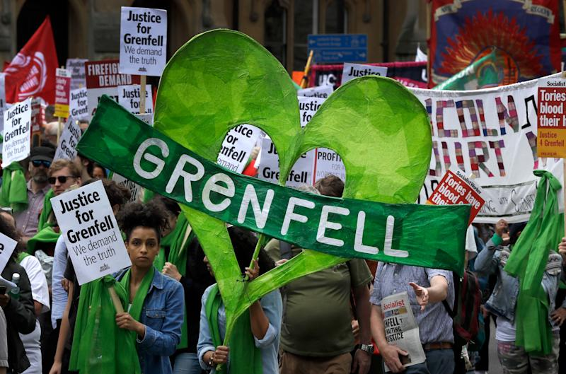 Demonstrators march in the Grenfell fire one-year anniversary solidarity march organised by Justice4Grenfell. (AP Photo/Kirsty Wigglesworth)