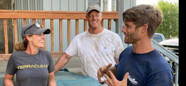 TerraClear Marketing Director Heidi Lindsley, CEO Brent Frei and President Trevor Thompson get together after picking about 30,000 rocks during the company's first customer service job. (TerraClear Photo)