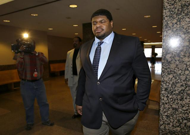 FILE - In this Jan. 17, 2014, file photo, Former Dallas Cowboys NFL football player Josh Brent leaves a courtroom following a day in his trial for intoxication manslaughter in Dallas. Brent is being allowed to return to the NFL, though he won't play right away. The NFL on Tuesday, Sept. 2, 2014, outlined a series of conditions Brent must meet to be eligible to play when the Cowboys return from their bye week in November. Brent retired last year and was sentenced to 180 days in jail after a trial in January in the intoxication manslaughter death of teammate Jerry Brown, a practice squad linebacker for the Cowboys. A 10-year prison sentence was suspended. (AP Photo/Tony Gutierrez, File)