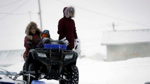 PHOTO: A family prepares to leave after services at the St. Peter Fisherman Church,, Jan. 19, 2020, in Toksook Bay, Alaska. (Gregory Bull/AP)