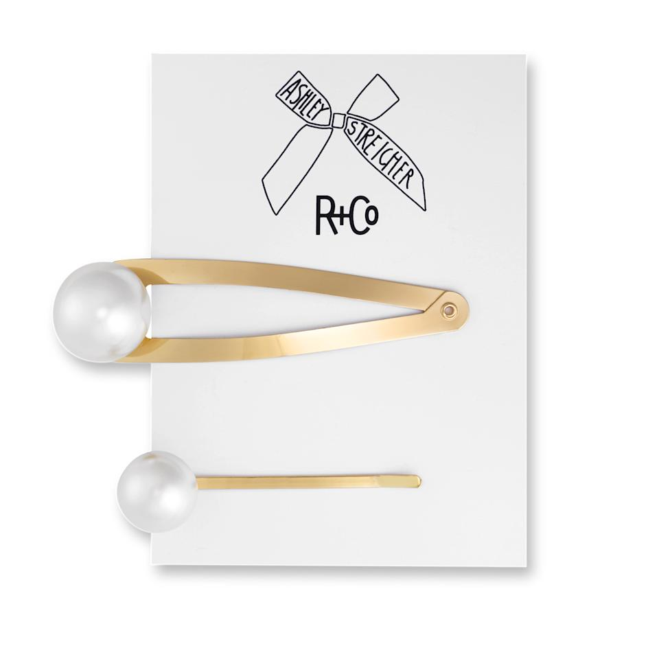 "Hairstylist Ashley Streicher loves a hair clip, so she teamed up with R+Co to give you two of them. The set comes with one snap clip and one bobby bin, both embellished with a faux pearl. Add them to an updo or use them to pull one side of your hair back.<br> <br> <strong>$50</strong> (<a href=""https://shop-links.co/1692230622951996135"" rel=""nofollow"">Shop Now</a>)"