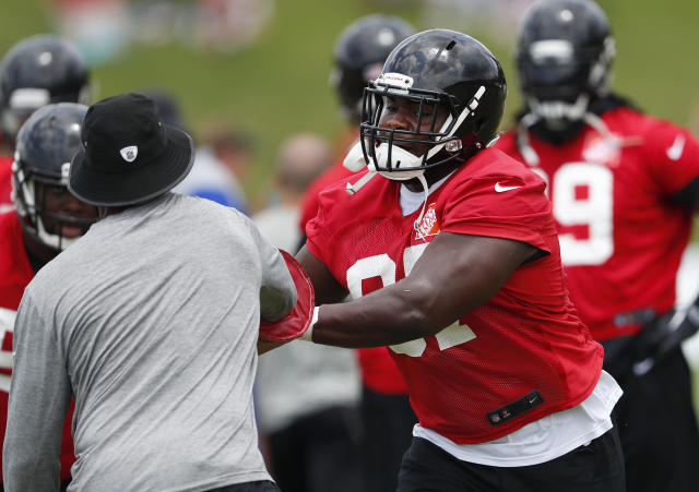 Atlanta Falcons defensive tackle Grady Jarrett (97) works a drill during NFL minicamp football Wednesday, June 13, 2018 in Flowery Branch, Ga. (AP Photo/John Bazemore)
