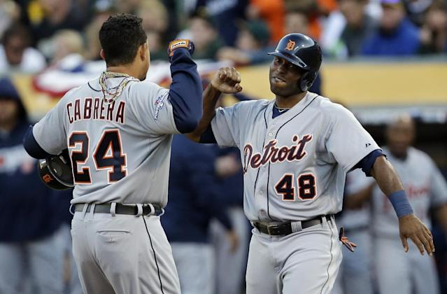 Detroit Tigers Miguel Cabrera (24) celebrates with teammate Torii Hunter (48) after he scored a two run home run that also scored Hunter in the fourth inning of Game 5 of an American League baseball division series against the Oakland Athletics in Oakland, Calif., Thursday, Oct. 10, 2013. (AP Photo/Marcio Jose Sanchez)