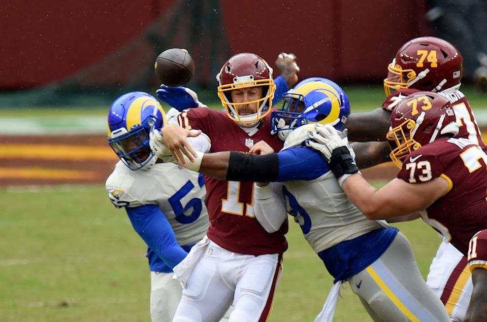 Aaron Donald gets to Alex Smith as he releases the ball.