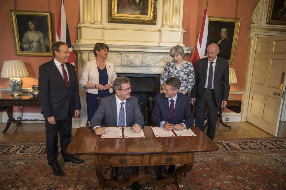 Theresa May signs a deal with the DUP's Arlene Foster, Nigel Dodds and Sir Geoffrey Donaldson after losing the Conservative Party's majority in the 2017 General Election (Getty Images)