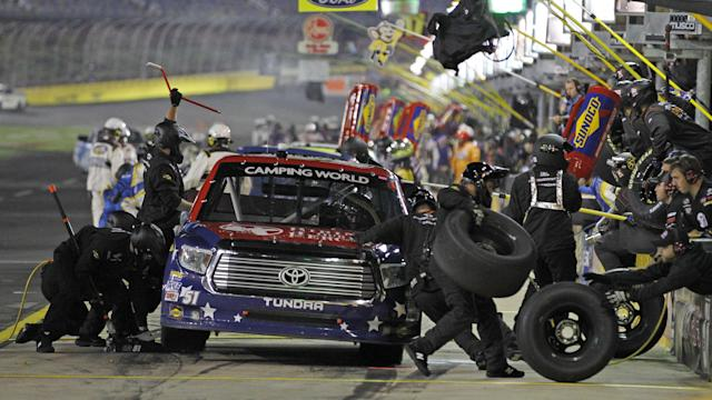 Kyle Busch pits during the NASCAR Trucks series auto race at Charlotte Motor Speedway in Concord, N.C., Friday, May 16, 2014. (AP Photo/Terry Renna)