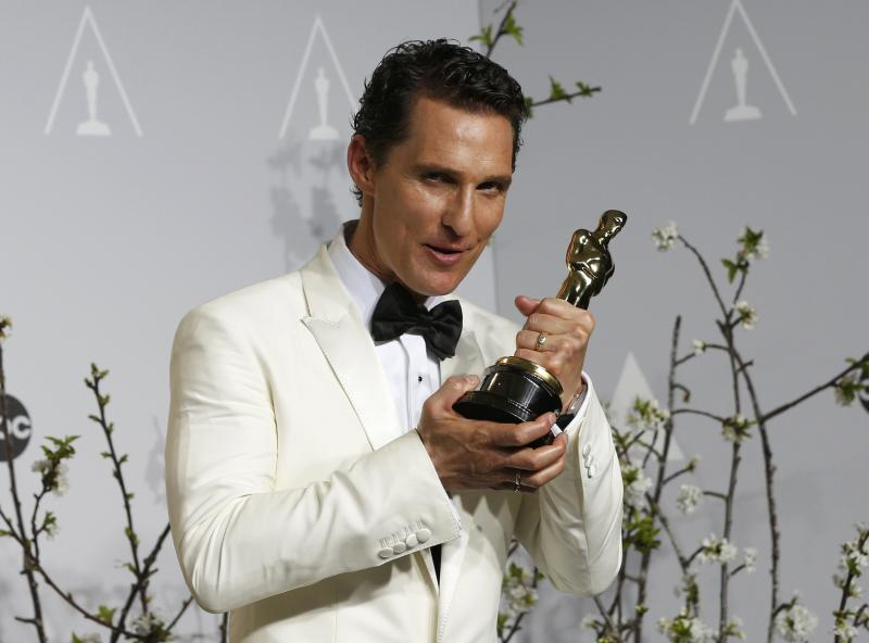 """Matthew McConaughey holds his Oscar for Best Actor for the film """"Dallas Buyers Club"""" at the 86th Academy Awards in Hollywood"""