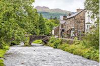 """<p>Beddgelert is undoubtedly Snowdonia's loveliest village. Rich in character, history and unrivalled views, this picturesque stone-built village is ideal for ramblers to spend a long weekend. Don't forget your <a href=""""https://www.countryliving.com/uk/travel-ideas/staycation-uk/a34093927/best-hiking-boots/"""" rel=""""nofollow noopener"""" target=""""_blank"""" data-ylk=""""slk:hiking boots"""" class=""""link rapid-noclick-resp"""">hiking boots</a>. </p>"""