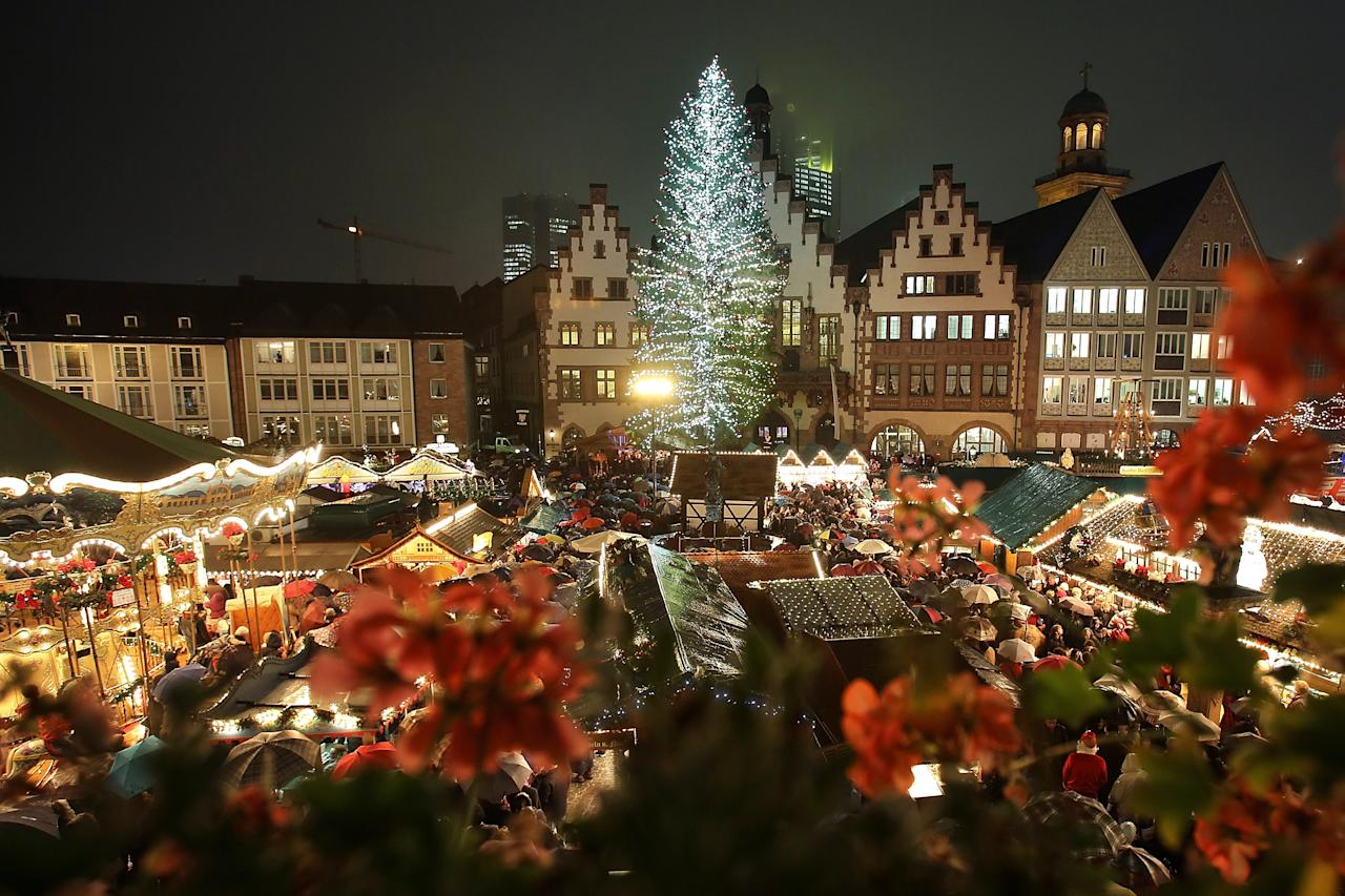 FRANKFURT, GERMANY - NOVEMBER 26:  The annual Christmas market is illuminated in the city center on its opening day on November 26, 2012 in Frankfurt, Germany. Christmas markets, with their stalls selling mulled wine, Christmas tree decorations and other delights, are an integral part of German Christmas tradition, and many of them opened across Germany today. (Photo by Hannelore Foerster/Getty Images)