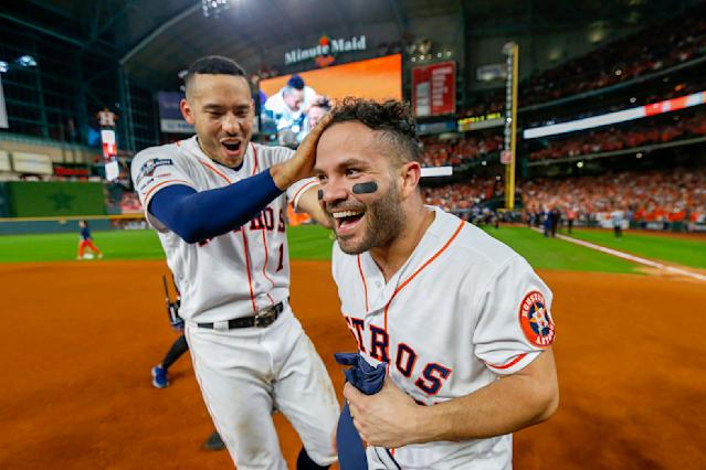 Jose Altuve does indeed have a tattoo on his left collarbone. (Photo by Elsa/Getty Images)