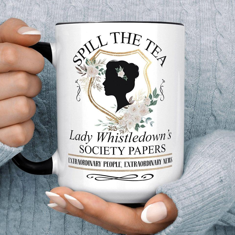 """<p><strong>FoxyMug</strong></p><p>Etsy</p><p><strong>$15.99</strong></p><p><a href=""""https://go.redirectingat.com?id=74968X1596630&url=https%3A%2F%2Fwww.etsy.com%2Flisting%2F970927511%2Fbridgerton-mug-lady-whistledown-society&sref=https%3A%2F%2Fwww.goodhousekeeping.com%2Fholidays%2Fgift-ideas%2Fg37622708%2Fbridgerton-gifts%2F"""" rel=""""nofollow noopener"""" target=""""_blank"""" data-ylk=""""slk:Shop Now"""" class=""""link rapid-noclick-resp"""">Shop Now</a></p><p>We can't think of a better way to burn over the Duke of Hastings than with a warm cup of tea in this microwaveable and dishwasher-safe mug. Choose between an 11 oz. or 15 0z. cup and customize with a white or black handle. </p>"""
