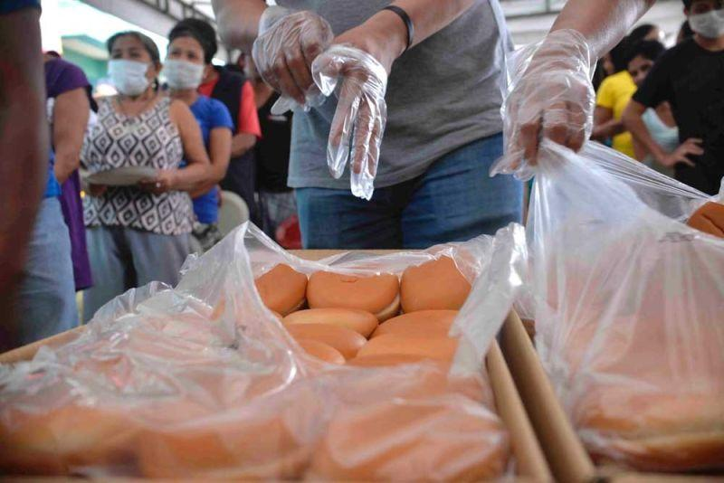 Local flour millers donate bread to Taal evacuees