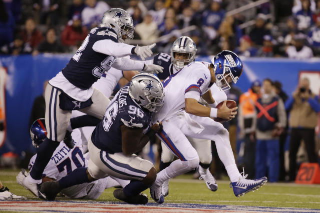 New York Giants quarterback Daniel Jones (8) is sacked by the Dallas Cowboys during the fourth quarter of an NFL football game, Tuesday, Nov. 5, 2019, in East Rutherford, N.J. (AP Photo/Adam Hunger)
