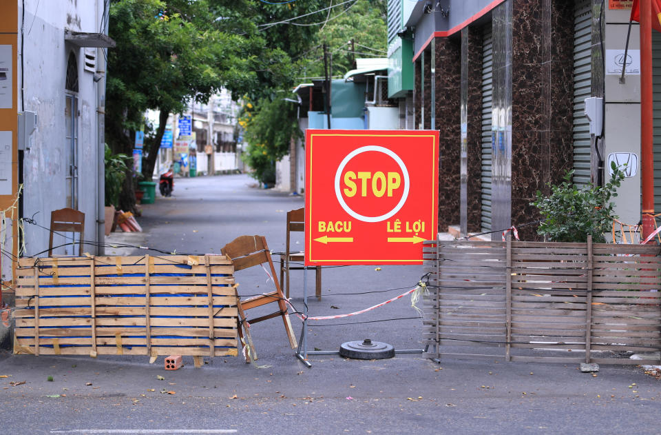 A street is blocked during a virus lockdown in Vung Tau, Vietnam on Sept. 13, 2021. More than a half of Vietnam is under a lockdown order to contain its worst virus outbreak yet.(AP Photo/Hau Dinh)