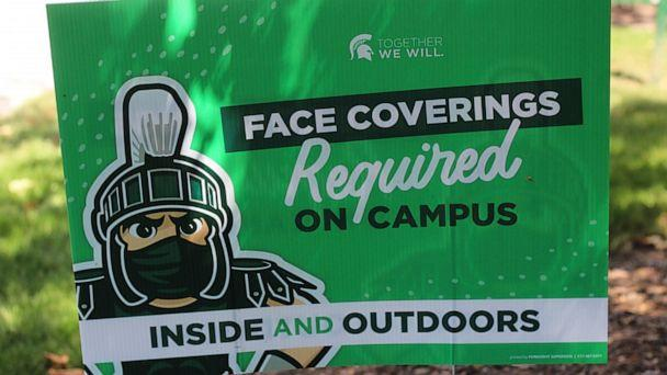 PHOTO: A sign outside the Michigan State University Student Union building alerts students to MSU's face covering rule on Friday, Aug. 21, 2020. (Anna Nichols/AP, File)