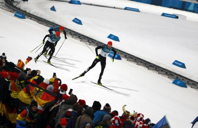 Nordic Combined Events - Pyeongchang 2018 Winter Olympics - Men's Individual 10 km Final - Alpensia Cross-Country Skiing Centre - Pyeongchang, South Korea - February 20, 2018 - Johannes Rydzek of Germany, Fabian Riessle of Germany and Eric Frenzel of Germany approach the finish line. REUTERS/Dominic Ebenbichler