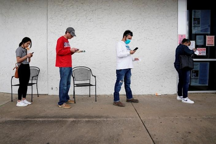 People in line to apply for unemployment benefits in Arkansas.