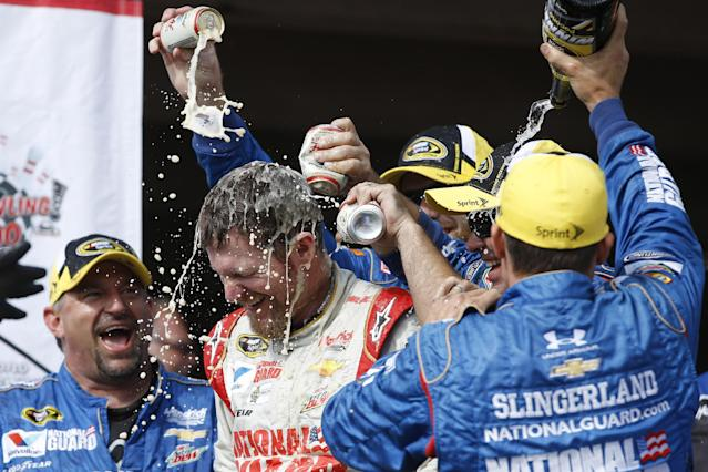 Dale Earnhardt Jr. is doused by crew members in Victory Lane after winning the the NASCAR Sprint Cup Series auto race at Pocono Raceway, Sunday, Aug. 3, 2014, in Long Pond, Pa. (AP Photo/Matt Slocum)