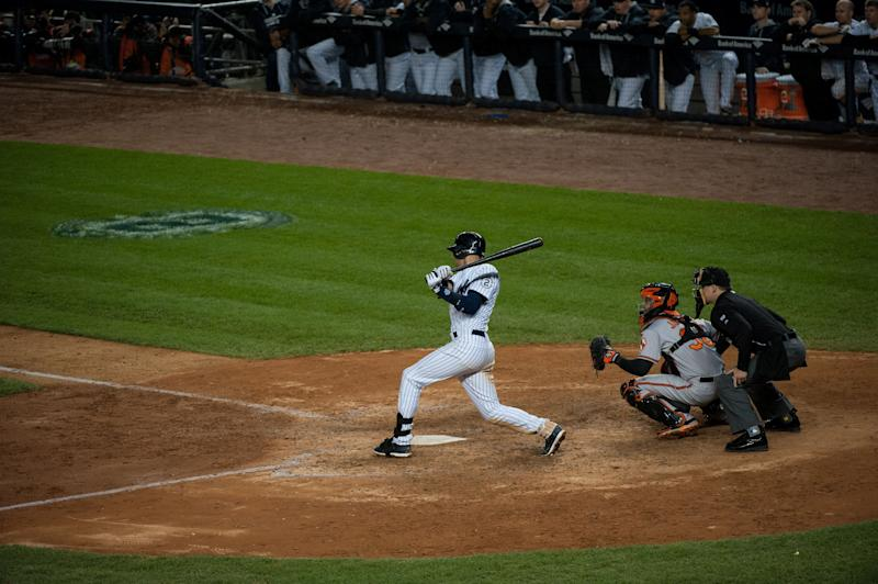 NEW YORK, NY - SEPTEMBER 25: Derek Jeter #2 of the New York Yankees hits a walk off single during the game against the Baltimore Orioles at Yankee Stadium on Thursday, September 25, 2014 in the Bronx Borough of New York. (Photo by Taylor Baucom/MLB Photos via Getty Images)