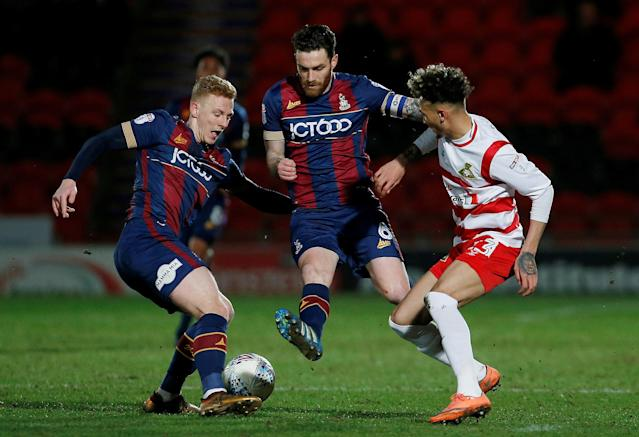 "Soccer Football - League One - Doncaster Rovers vs Bradford City - Keepmoat Stadium, Doncaster, Britain - March 19, 2018 Bradford City's Callum Guy and Romain Vincelot in action with Doncaster Rovers' Alex Kiwomya Action Images/Craig Brough EDITORIAL USE ONLY. No use with unauthorized audio, video, data, fixture lists, club/league logos or ""live"" services. Online in-match use limited to 75 images, no video emulation. No use in betting, games or single club/league/player publications. Please contact your account representative for further details. TPX IMAGES OF THE DAY"